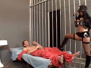 Huge-chested Dark Haired Is Wearing Only Stockings And Boots With High Stilettos While Sucking Dick In The Jail