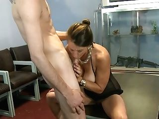 Horn-mad Dark Haired Gargles A Stiff Dick And Begs To Fuck Her Raunchy On The Table